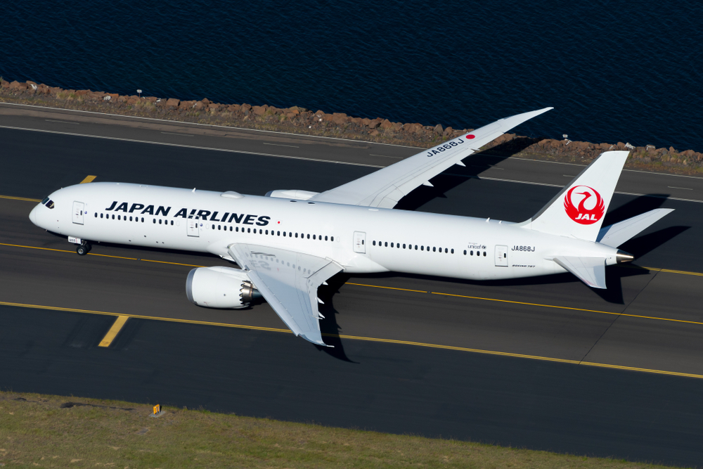 Japan Airlines (also know as JAL) Boeing 787 9 Dreamliner taxiing in airport seen from above. Long haul flights to Haneda and Narita Airport. Aircraft aerial view.