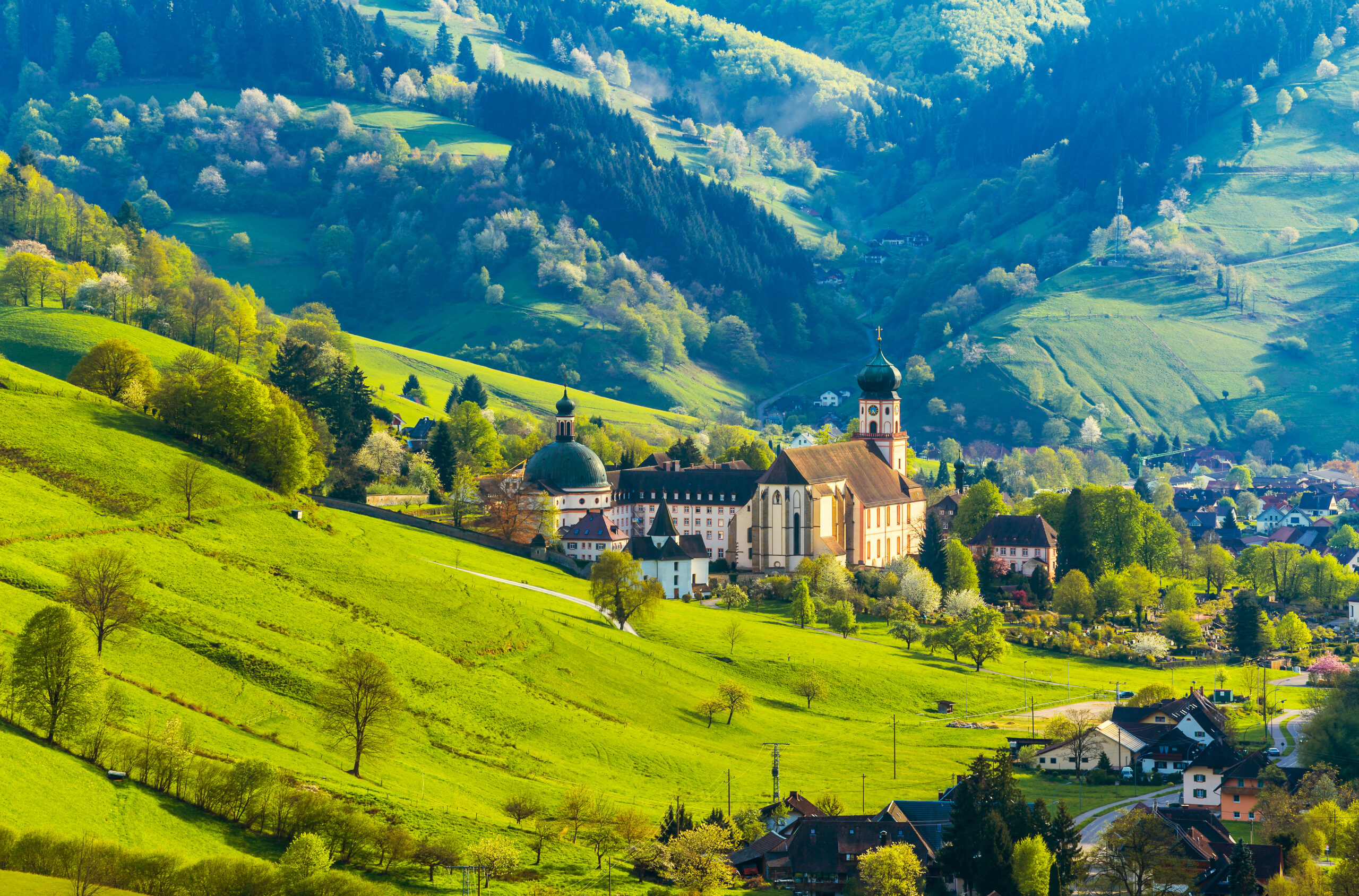 Beautiful countryside mountain landscape with a monastery in village. Germany.