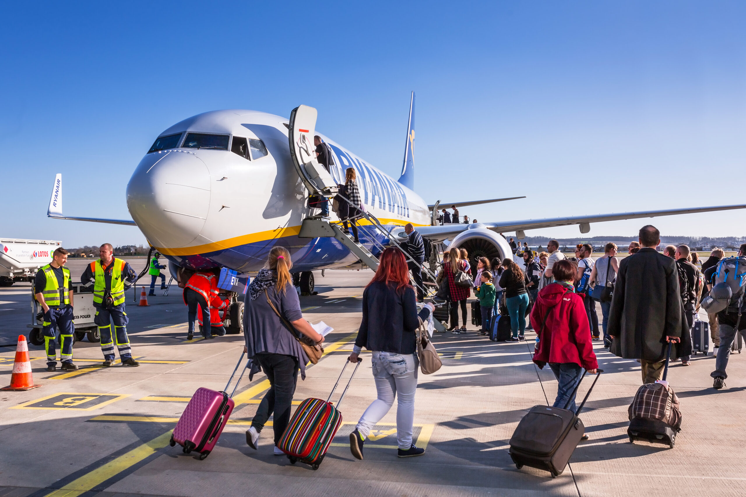 People boarding to Ryanair plane on Lech Walesa Airport in Gdansk. Ryanair operates over 300 aircraft and is the biggest low-cost airline company in Europe.