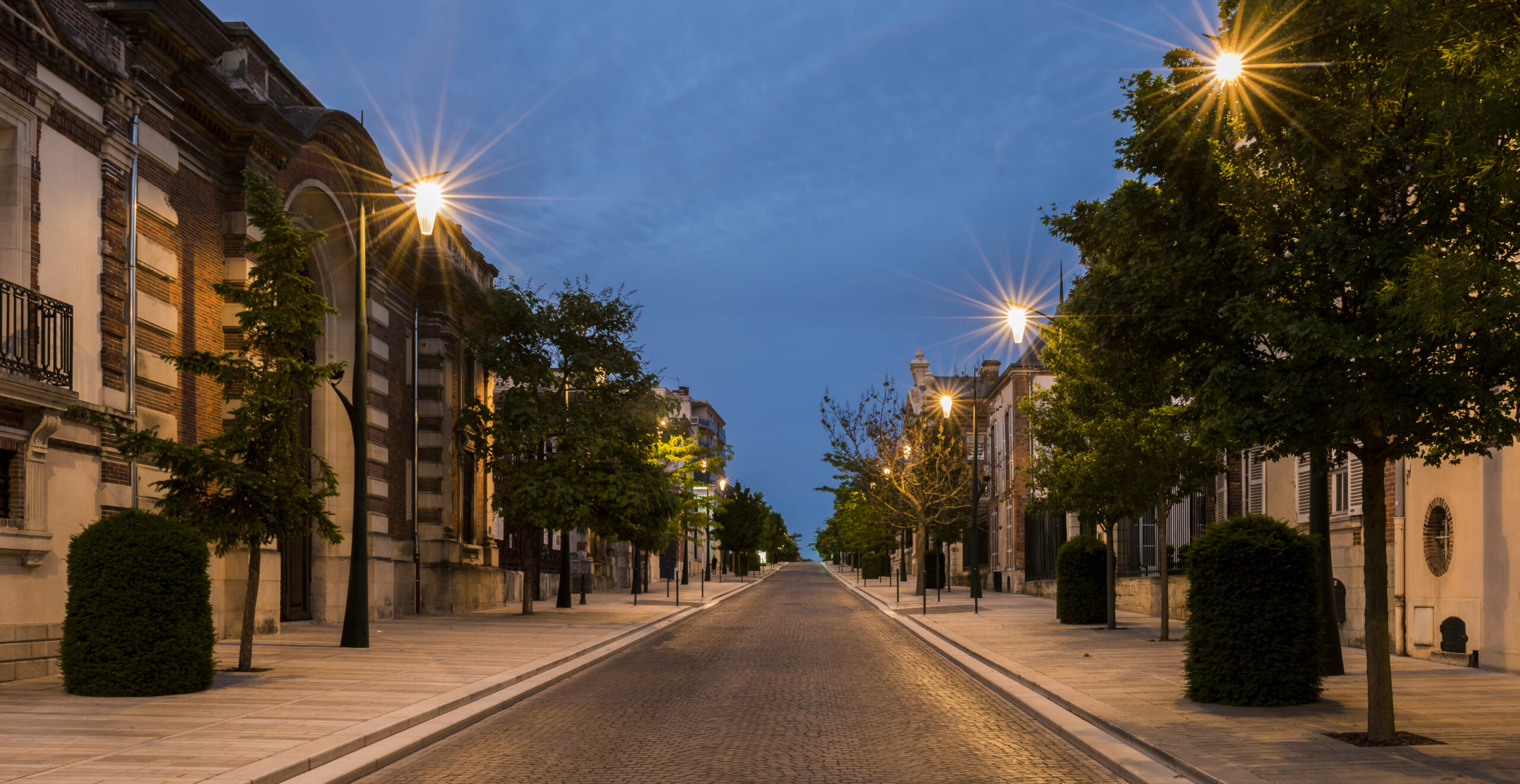 Avenue de Champagne with several Champagne houses along the road with strolling tourists in the evening in Epernay, France.