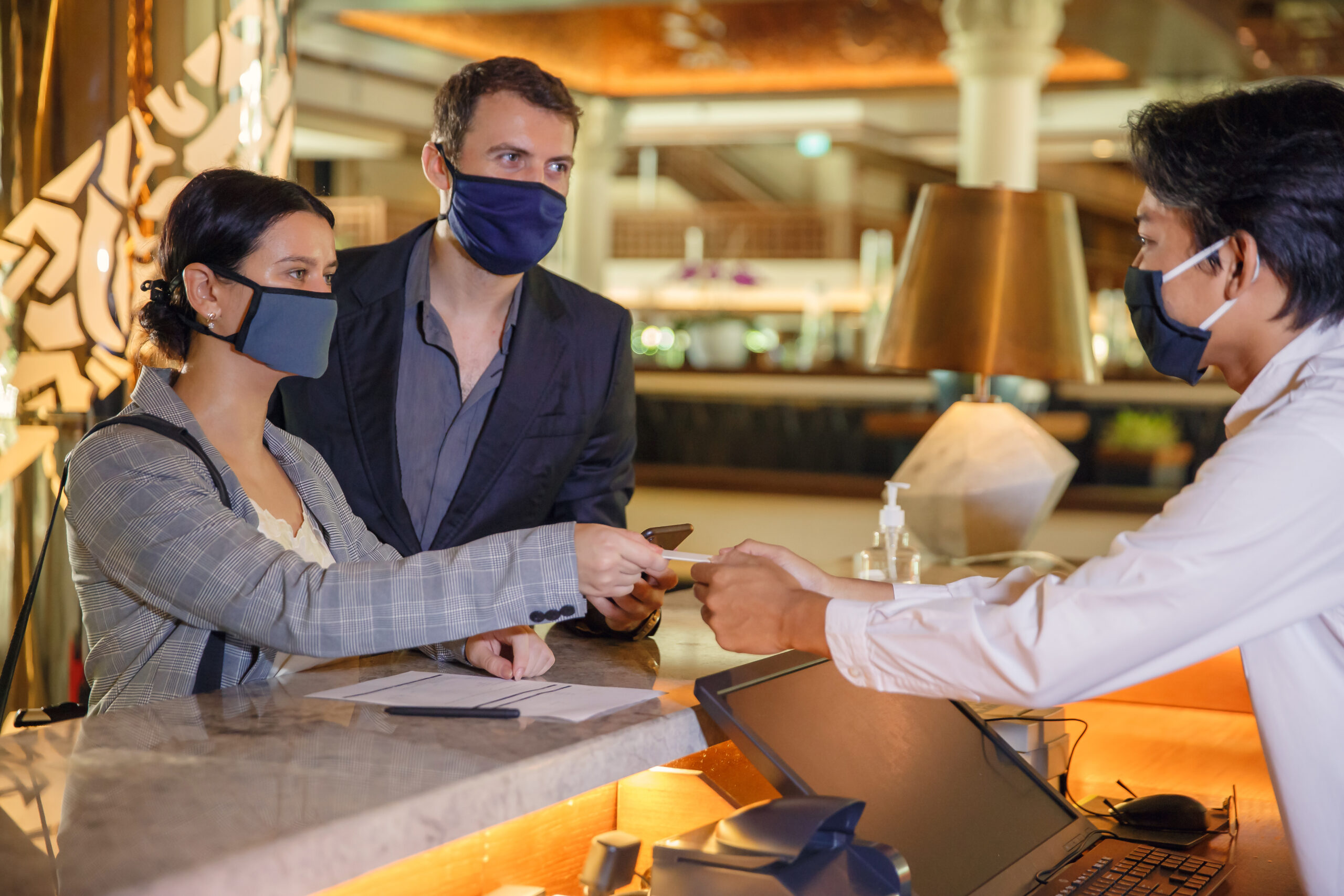 Checking into a hotel is relatively low risk if everyone is using a mask.