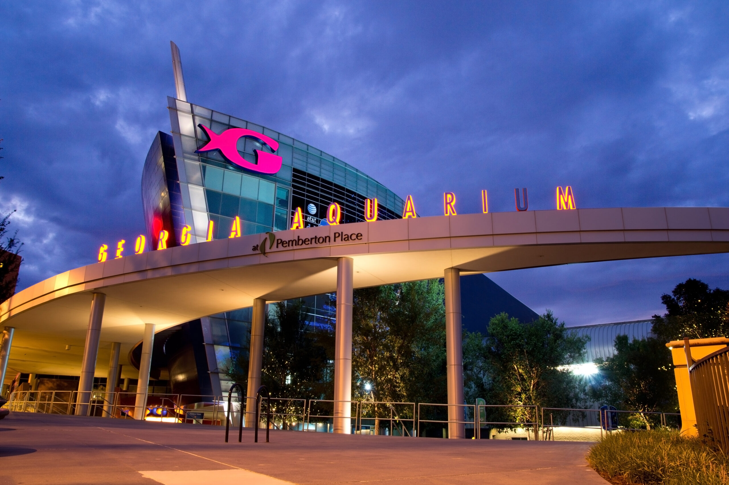 The Georgia Aquarium facade at night in Atlanta, Georgia. The boat shaped landmark is the world's largest aquarium with more than 8 million gallons of water.