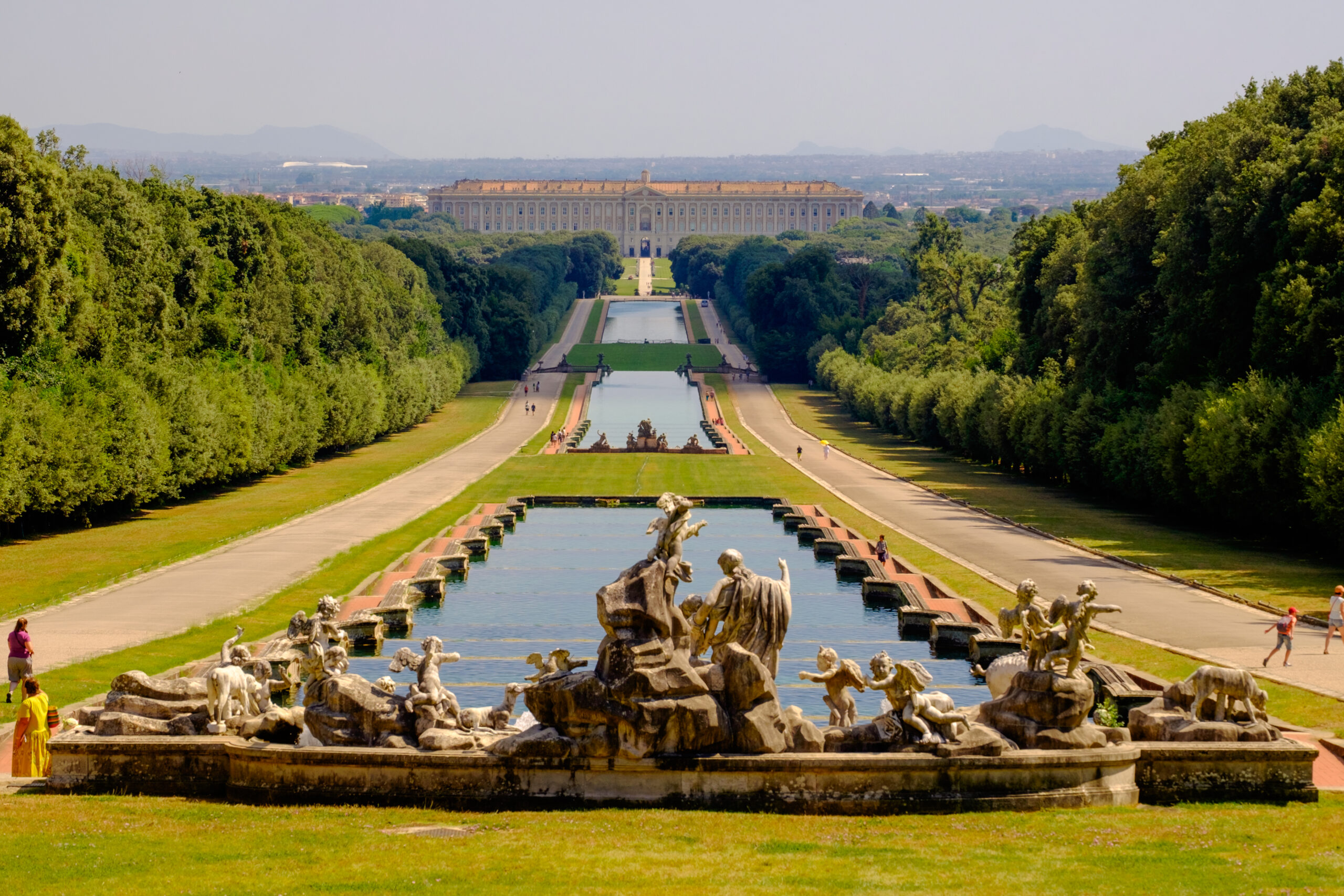 The 'Reggia di Caserta', in the background, is a former royal palace. The huge garden is 3 kilometers long and has sculptures and canals.