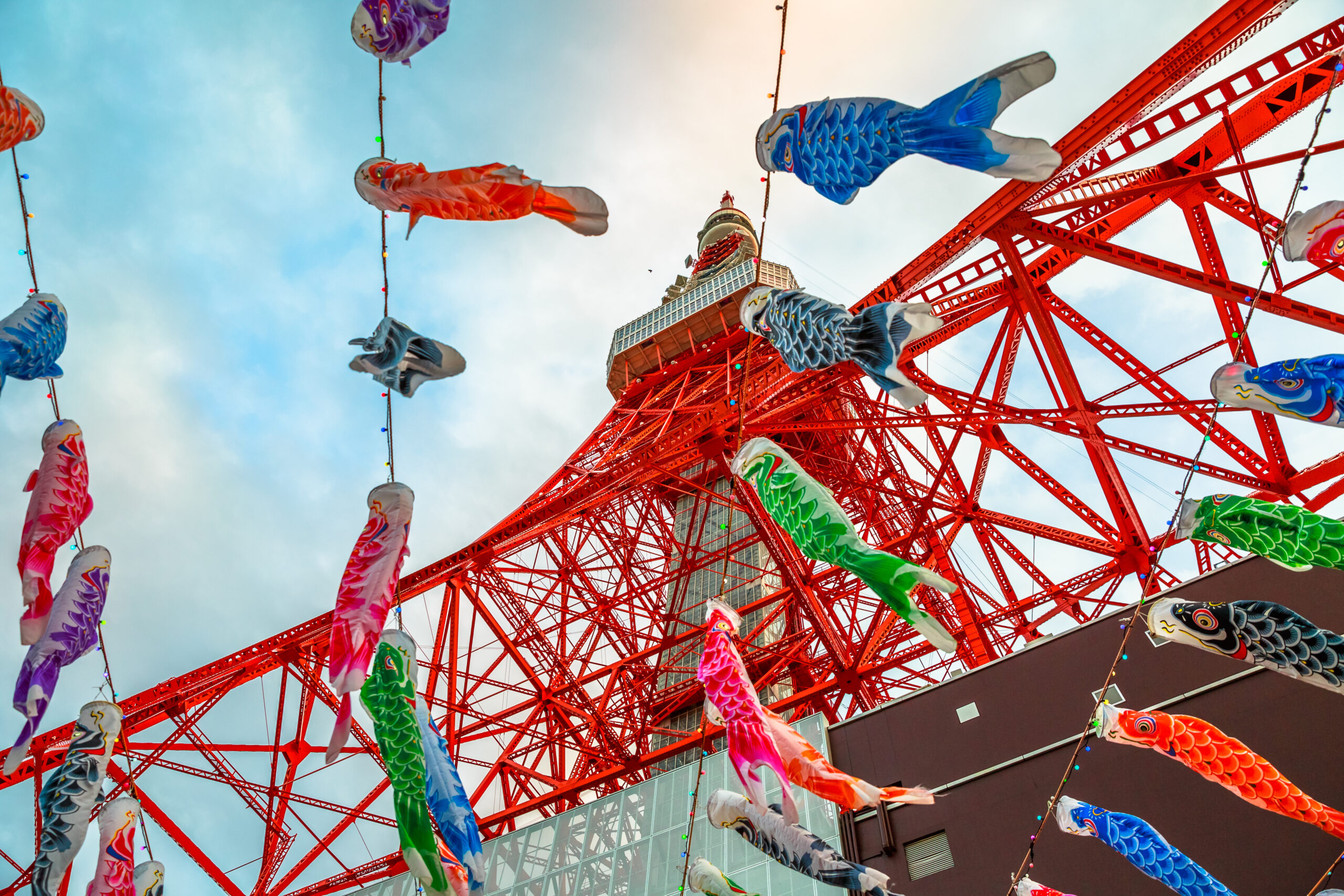 View of colorful Koinobori at Tokyo Tower. Koinobori are carp-shaped wind socks traditionally flown in Japan to celebrate Children's Day during the Golden Week.