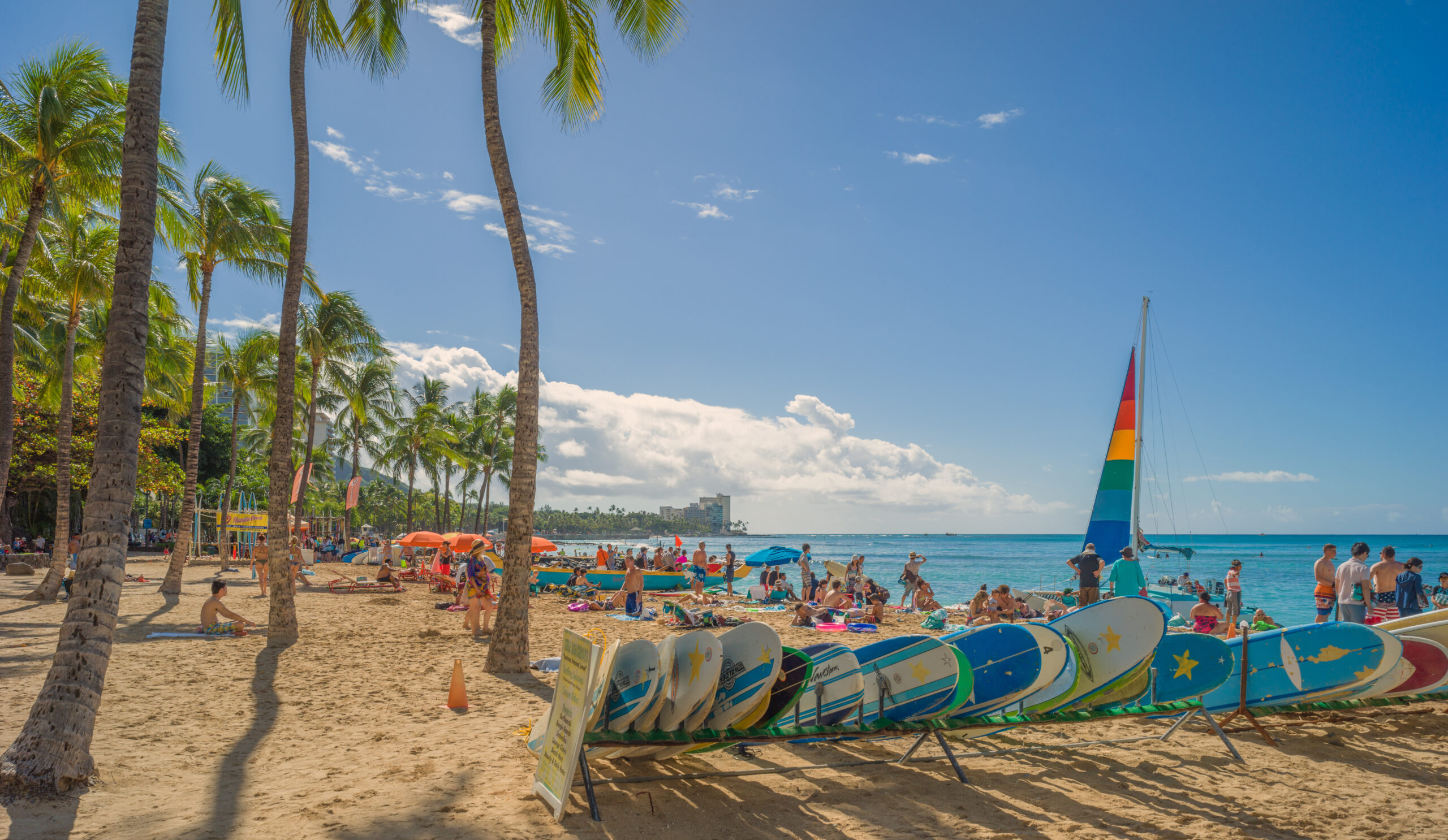 Waikiki Beach scene on a warm Winter morning as tourists and residents gather for a day in the sun and surf. Waikiki is just as famous to surfers as it is to beachgoers.