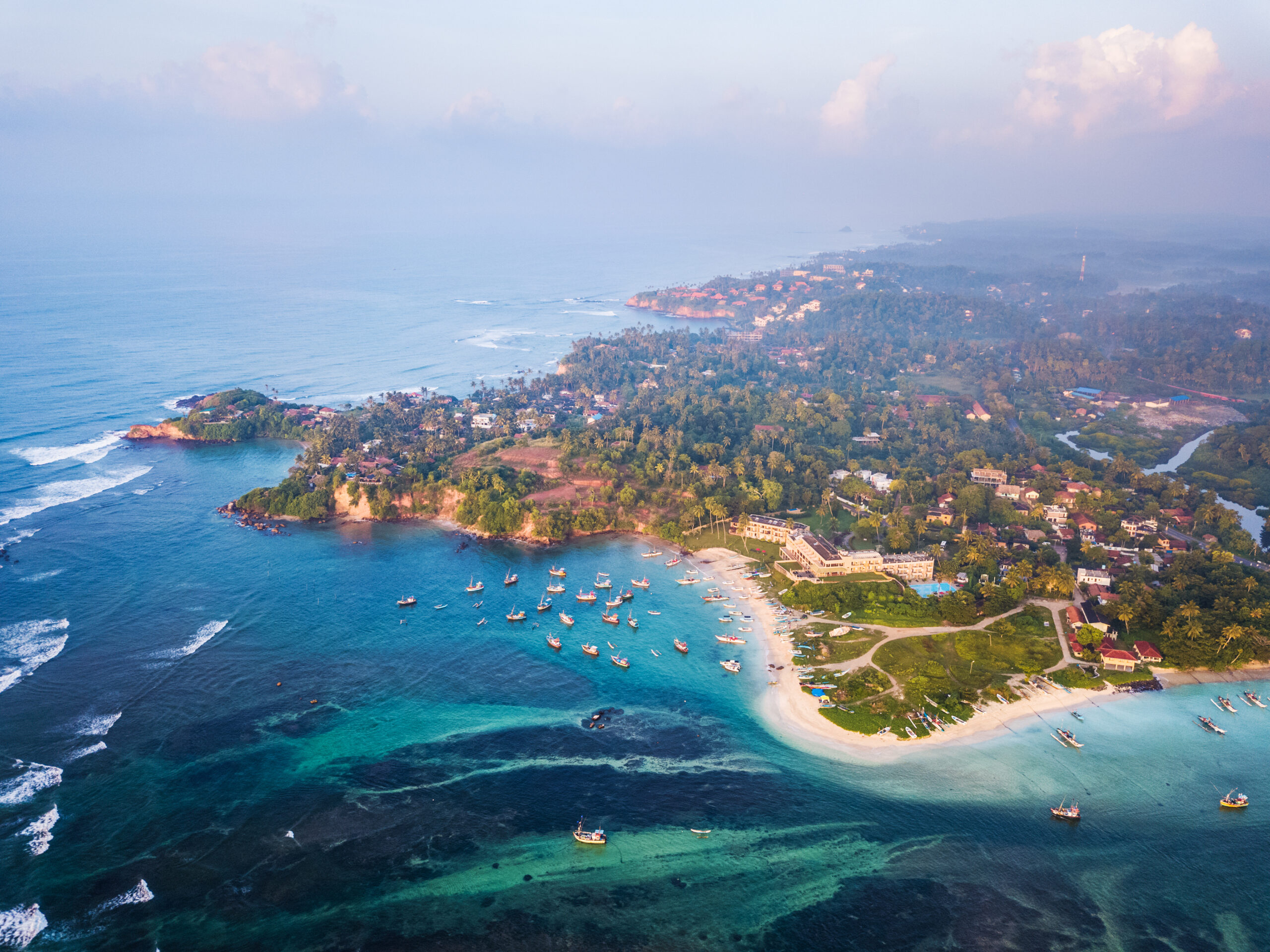 Aerial view of the Weligama cape with fishing village at sunrise, Sri Lanka.
